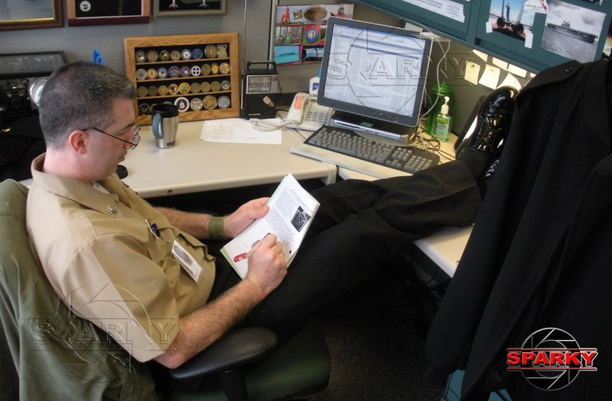 A blast from the past--me at my desk at the Defense Information School. I was editing a photojournalism handbook I was drafting while assigned as a journalism/photojournalism instructor. All potentially private information has been intentionally blurred out. (28 Jan. 2009; photo by TSgt Jess Harvey, USAF).
